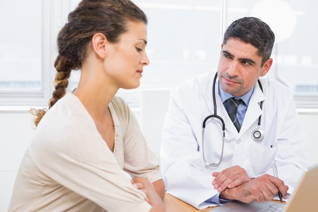 Doctor and patient in discussion at medical office
