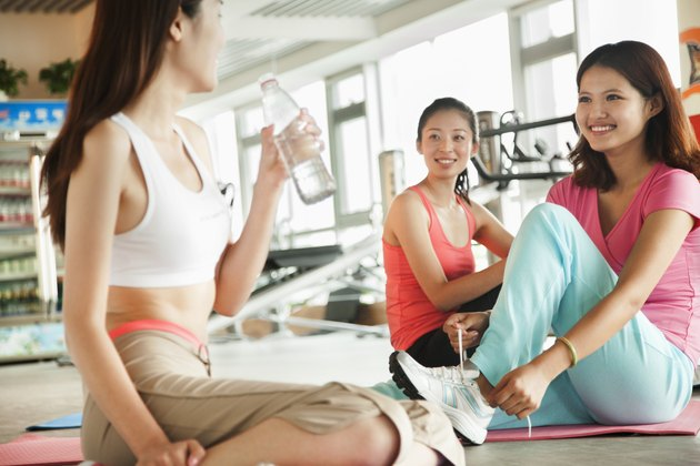 Young women after training in the gym