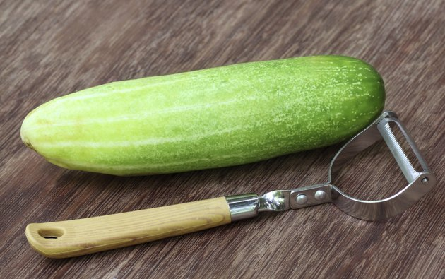 Fresh cucumber with peeler