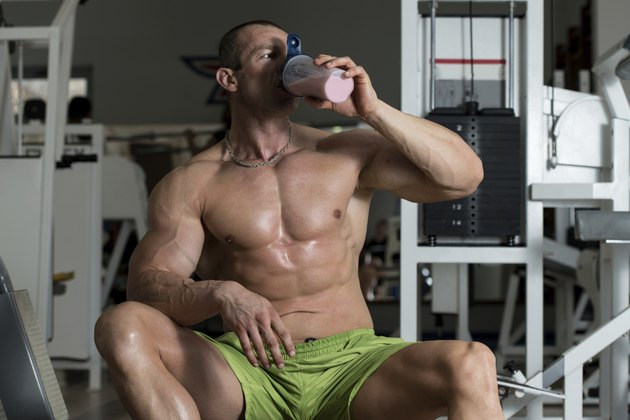 Bodybuilder Drinking From A Bottle Of Water