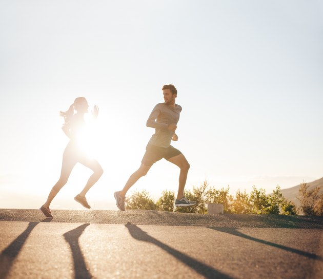 Young people running on country road