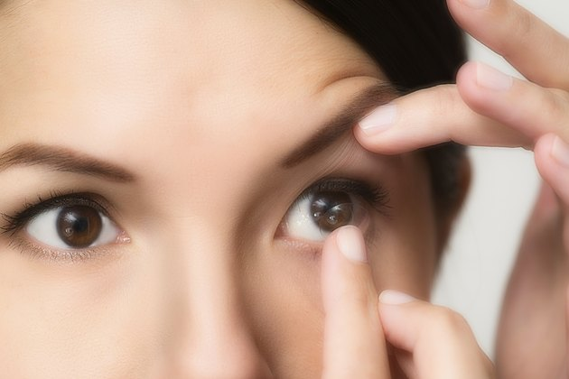 Woman about to place a contact lens in her eye