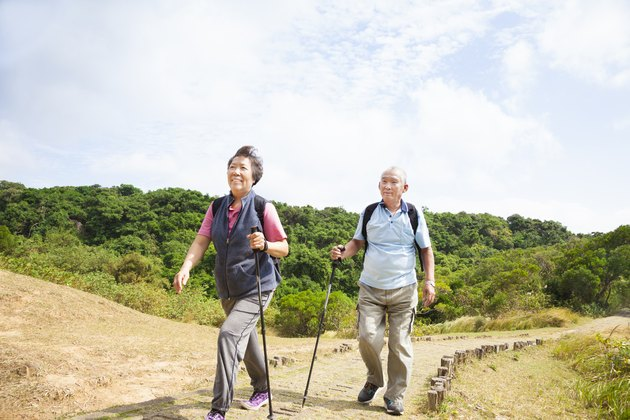 asian senior couple hiking