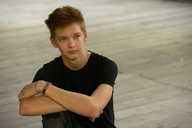 Teenager boy with hope outdoors