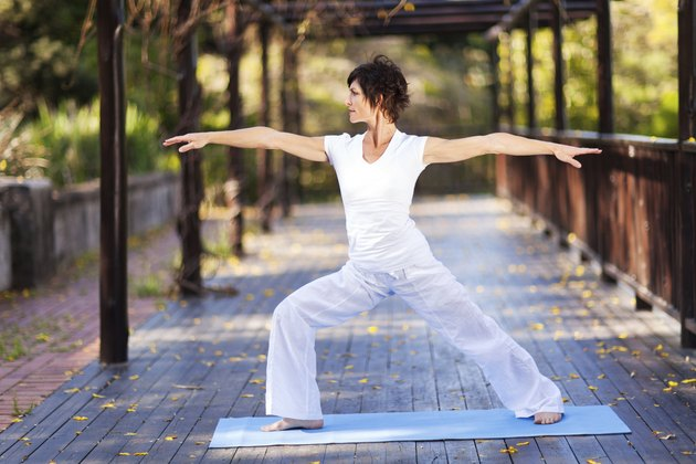 middle aged woman doing yoga
