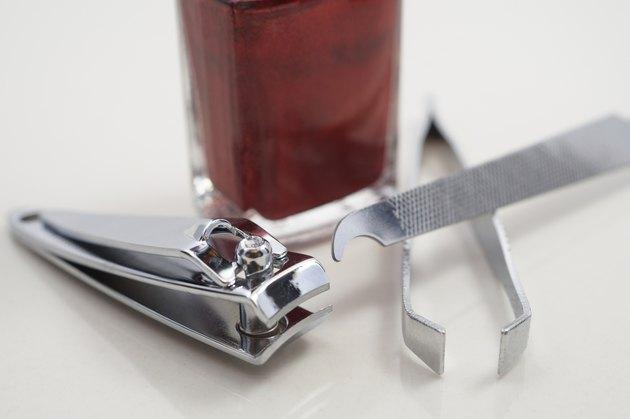 Nail clipper, file, nail polish and tweezer