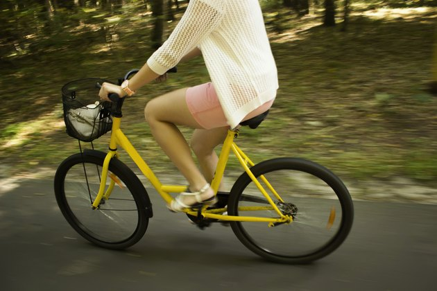 Motion blur.Riding yellow bicycle on the forest road.