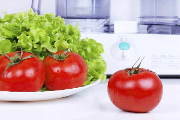 Tomatoes with green salad and kitchen processor