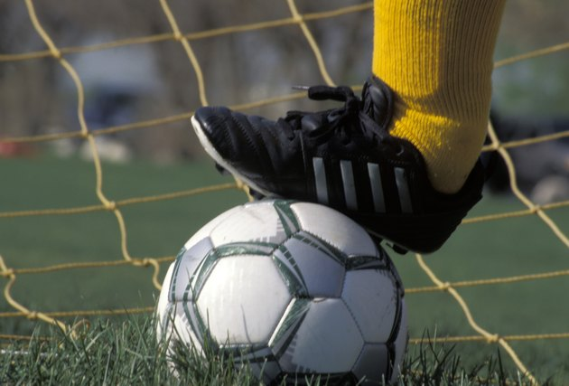 Goalie With Foot on a Soccer Ball
