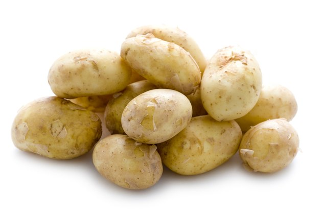 new potatoes on white background