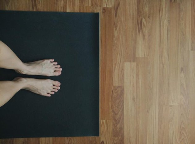 Feet on yoga mat, doing yoga at home, taken with mobile phone