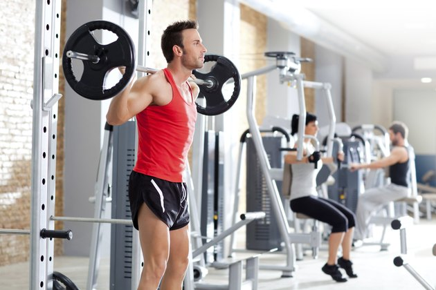 man with dumbbell weight training equipment  gym