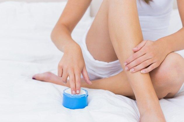 Woman putting some moisturising cream