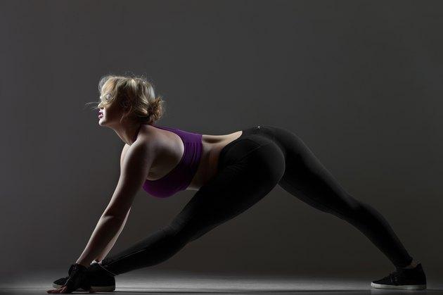 Beautiful sporty girl warming up