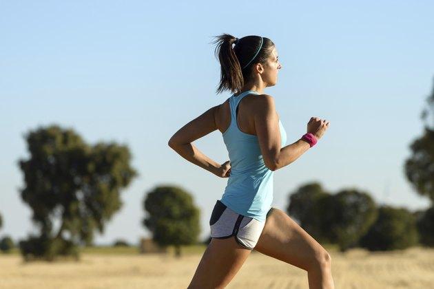 Woman running cross trail