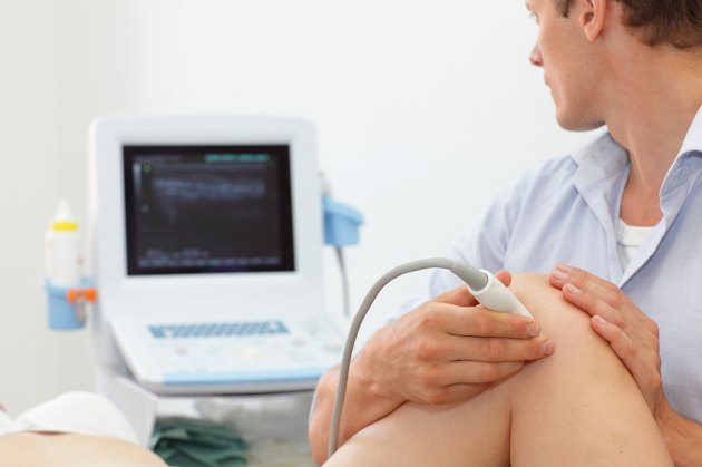 female patient's knee joint dynamic test with ultrasound