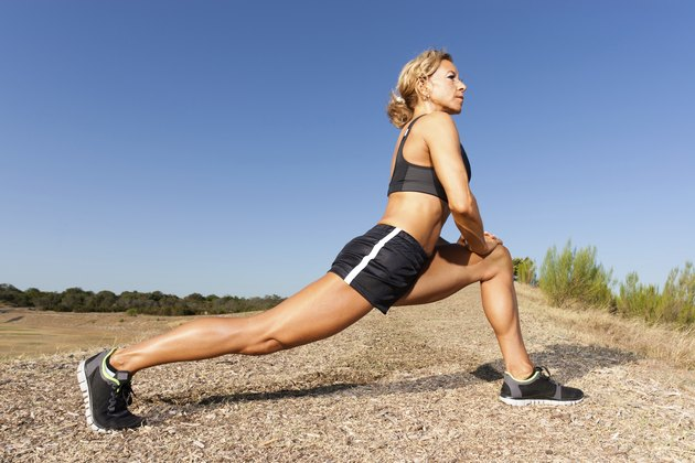 Middle Aged Woman Stretching Before Running