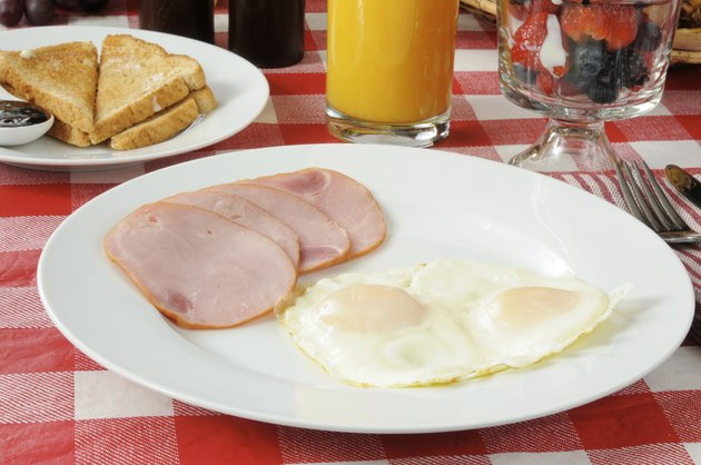 Canadian bacon breakfast with fruit cocktail