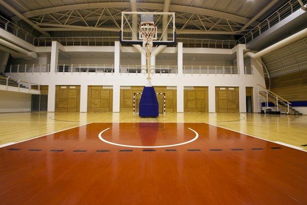 Below the basket on a gymnasium