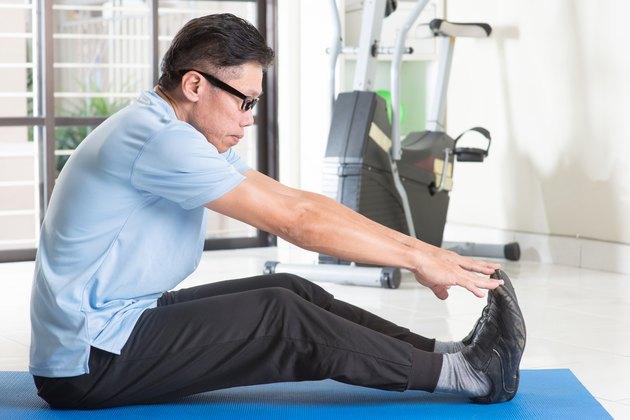 Mature Asian man workout at gym