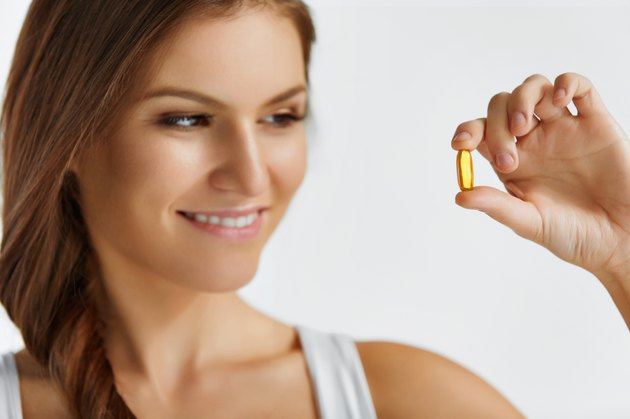 Vitamins. Healthy Eating. Happy  Girl With Omega-3 Fish Oil Caps