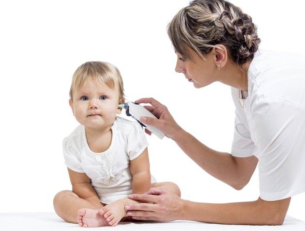 doctor measuring  temperature cute baby girl