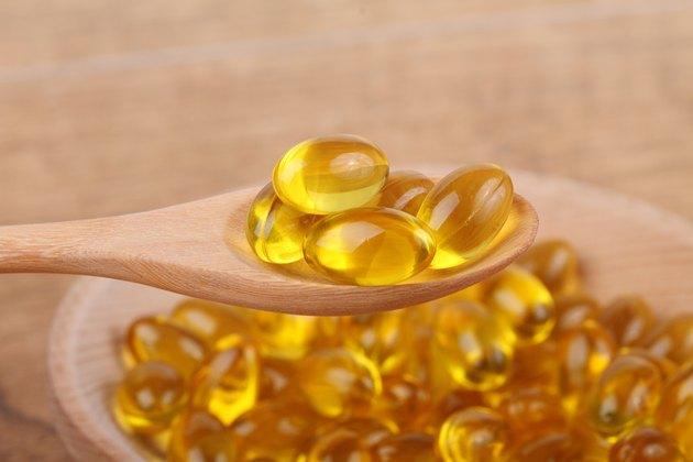spoon of vitamin capsules