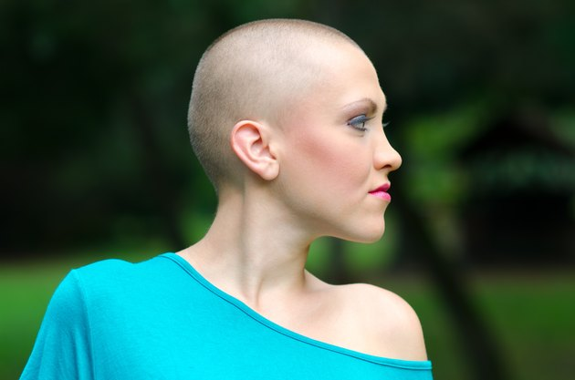 Bald cancer survivor in summer nature