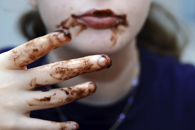 Girl eating chocolate