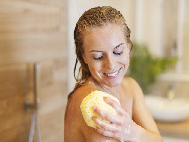 Beautiful blonde woman taking shower