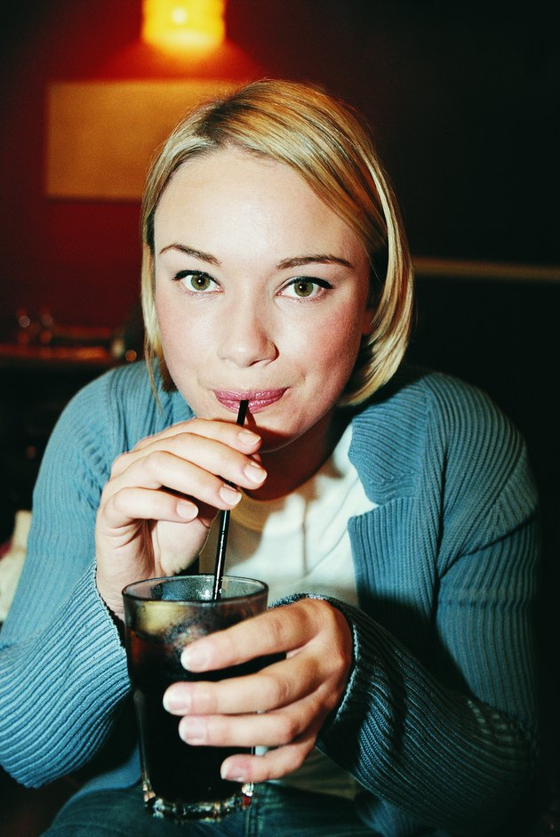 Portrait of a Young Woman Drinking Cola