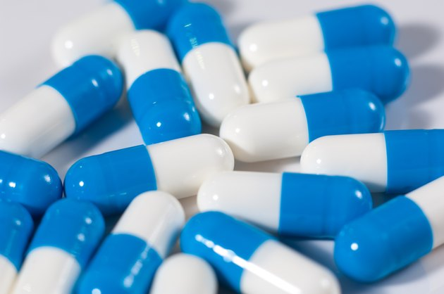 Background of blue and white capsule pills