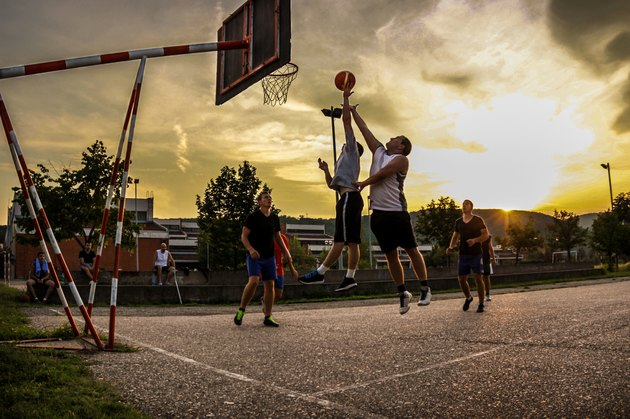 Street basketball at sunset