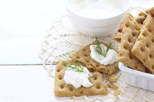Snack gluten free crackers with cream cheese and dill