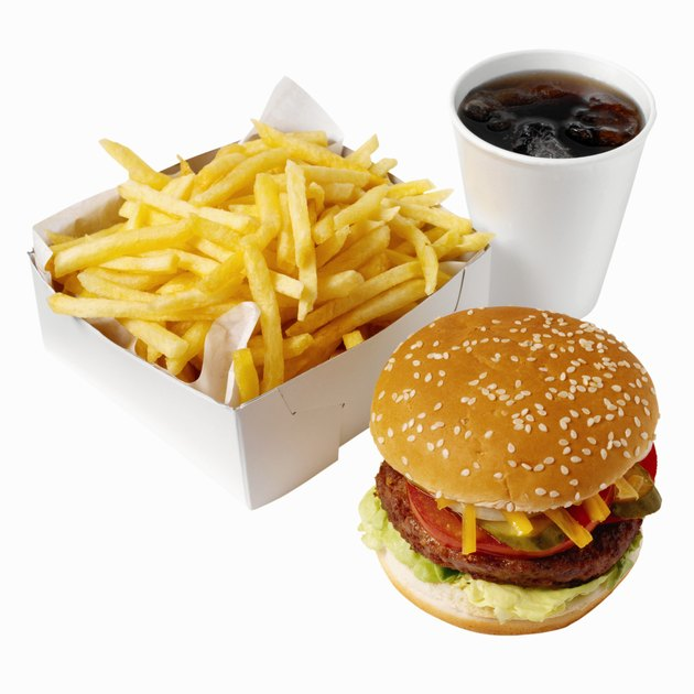Close-up of burger and french-fries with cold drink