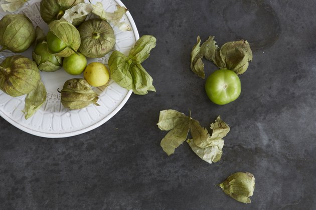Fresh tomatillos on a plate.