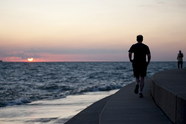Jogger running along Lake Michigan, Chicago, Illinois