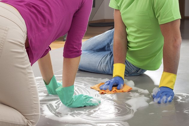 Couple cleaning floor