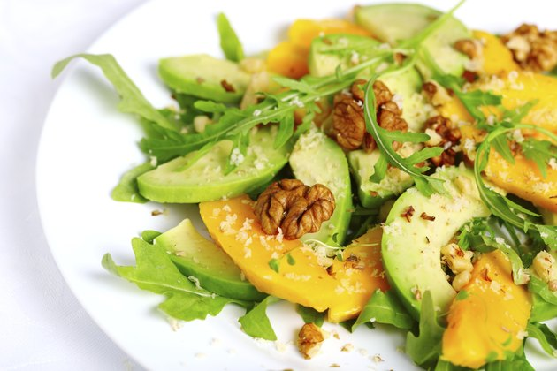 Salad with mango, avocado, arugula and walnuts