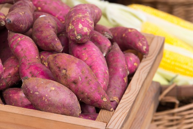 fresh purple yams in wooden box
