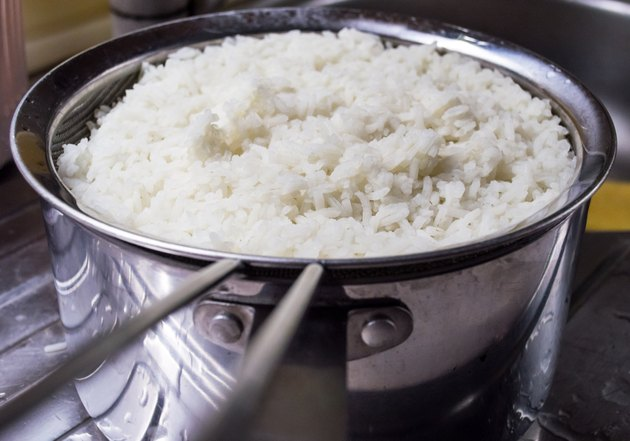 Freshly Cooked White Rice in a Strainer Near a Sink
