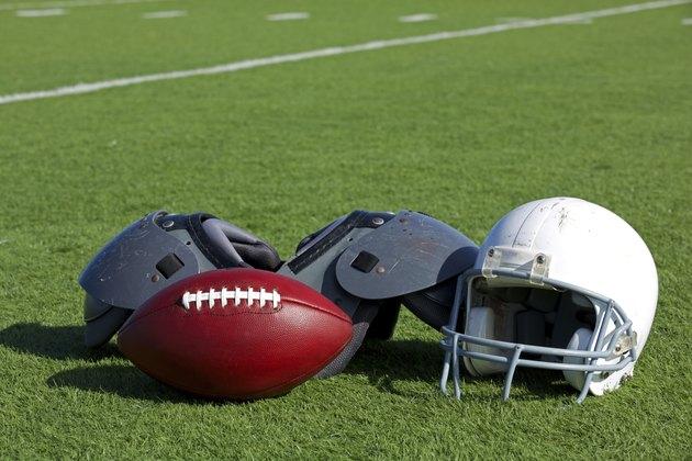 American Football and Helmet on the Field