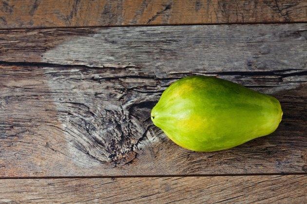 Papaya on wood
