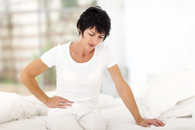 mature woman having stomach ache