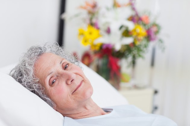 Peaceful senior woman lying in a hospital bed