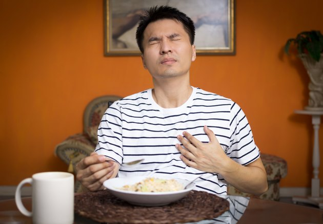 Asian man has a Heart attack symptoms while eating
