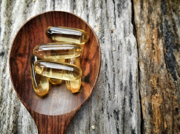 Close-up overhead view of cod liver oil capsules