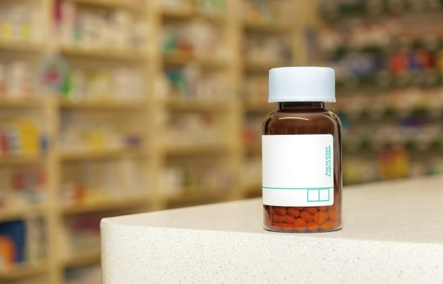 Medicine bottle with pills and a blank label