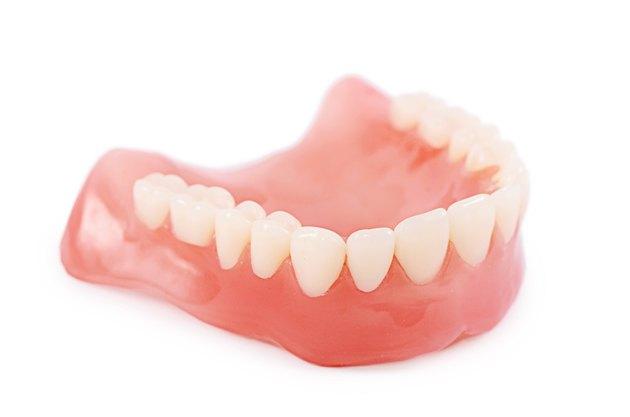 Set of false teeth isolated on white background