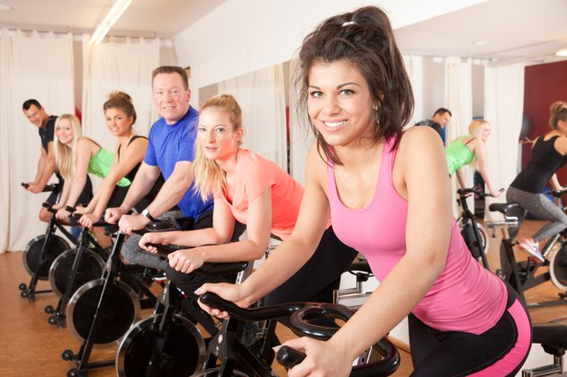 spinning cycling group of fitness people